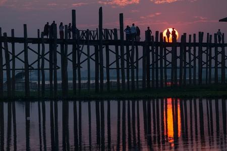 teck: U bein wooden teck bridge with sunset behind the structure, Amarapura, Myanmar (Burma) Stock Photo