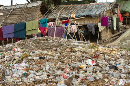 toxic: Laundry drying under a large rubbish pile in a slum area in Mandalay, Myanmar