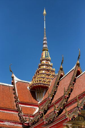 spire: Spire and roof of the Wat Chalong Buddhist temple in Chalong, Phuket, Thailand Stock Photo