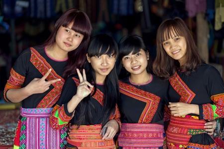 vietnamese ethnicity: MAI CHAU, VIETNAM, DECEMBER 20, 2015 : Group of tourists Vietnamese girls wearing traditional Hmong ethnicity costume, posing in the village of Mai Chau, Vietnam. Editorial