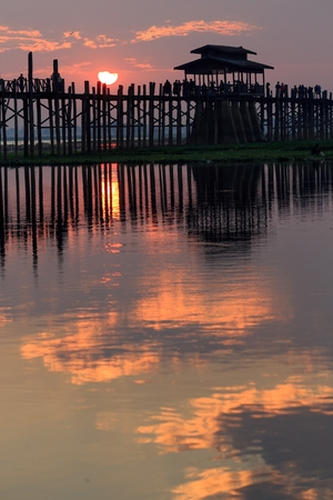 teck: U bein wooden teck bridge at sunset in Amarapura, Myanmar (Burma) Stock Photo