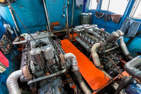 engine room: Big boat engine inside a tourist passenger boat in Thailand Stock Photo
