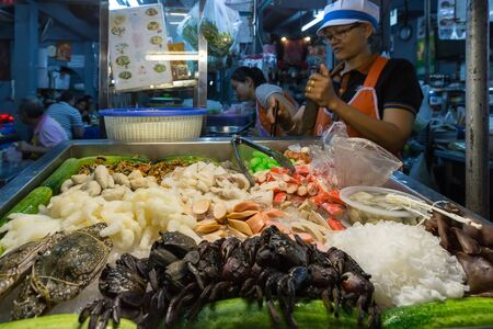 soi: BANGKOK, THAILAND, JANUARY 13, 2015 : View on the stall of a seafood restaurant in the street (soi) 38 in the Thong Lor district, Bangkok, Thailand Editorial