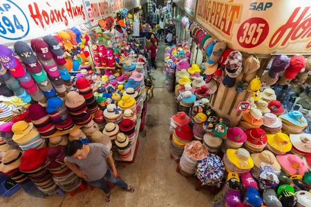 tay: HO CHI MINH CITY, VIETNAM, FEBRUARY 26, 2015: Hat department in the old traditional market of Cho Binh Tay in the Chinatown district of Ho Chi Minh City, Saigon, Vietnam.
