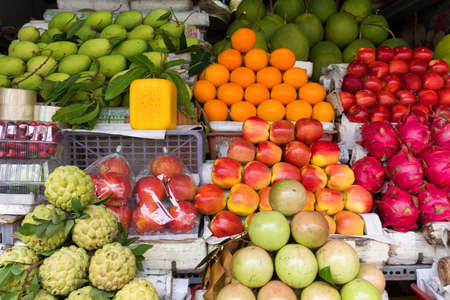 fruit market: Tropical fruit stall in an East Asian market Stock Photo