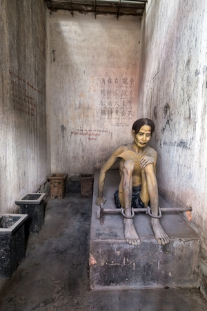 Model of a Vietnamese chained prisoner from French colony in a convict prison room in the Con Dao island, Vietnam Editorial