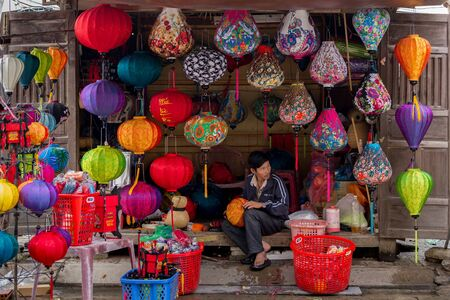 hoi an: HOI AN VIETNAM, DECEMBER 14, 2014 : A man is selling colorful hand crafted paper lantern in the streets of Hoi An, Vietnam