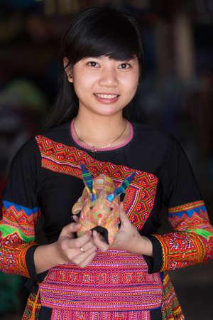 vietnamese ethnicity: MAI CHAU, VIETNAM, DECEMBER 20, 2015 :A tourist Vietnamese girl is wearing a traditional Hmong ethnicity costume, posing in the village of Mai Chau, Vietnam. Editorial