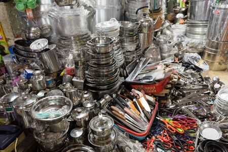 decoration messy: Kitchen utensils Asian shop in the Cho Binh Tay market, saigon, Vietnam Stock Photo