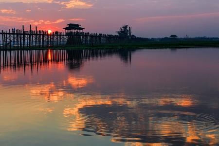 teck: U bein wooden teck bridge with reflections at susnet in Amarapura, Myanmar (Burma)