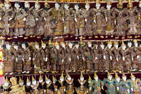 Rows of traditional Burmese puppets called Yoke the , Myanmar Stock Photo