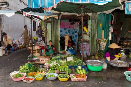 tay: HO CHI MINH VILLE, VIETNAM, FEBRUARY 26, 2015 : A family is selling vegetables and fishes in the street at the  Cho Binh Tay market in the Chinatown district of Ho Chi Minh Ville, (Saigon), Vietnam. Editorial