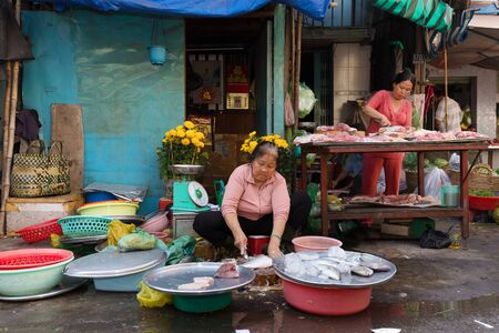 tay: HO CHI MINH VILLE, VIETNAM, FEBRUARY 26, 2015 : A woman is selling fishes in the street at the Cho Binh Tay market in the Chinatown district of Ho Chi Minh Ville, (Saigon), Vietnam.