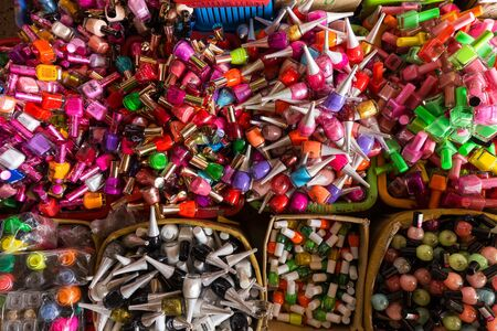 tay: HO CHI MINH, VIETNAM, FEBRUARY 26, 2015 : A big and colorful bunch of cheap cosmetics nail polish in the market of Cho Binh Tay in Ho Chi MInh city (Saigon), Vietnam