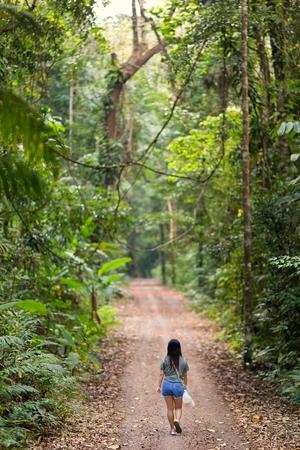 kood: Woman walking in a jungle path in the Ko Kood island in Thailand