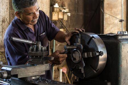 turner: Thai mechanic turner using machinery in his workshop