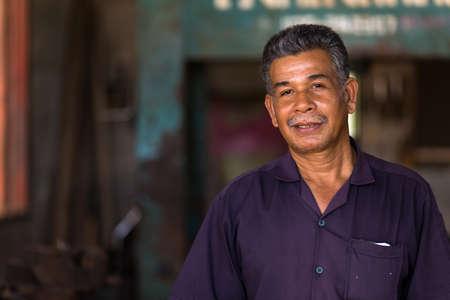 turner: Portrait of a Thai mechanic turner in his workshop, Thailand
