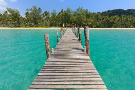 mook: Wooden pontoon in the turquoise tropical sea of Ao Phrao beach in Ko Mook island, Thailand .