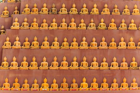 in wa: Tiny Buddha statues row in Wat Tam Phu Wa temple in Kanchanaburi, Thailand