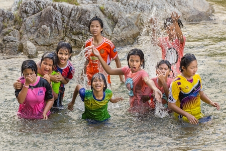 manora: MANORA WATERFALL, THAILAND, JANUARY 09, 2016 : A group of Thai children is having fun at the Manora waterfall in Phatthalung province, Thailand