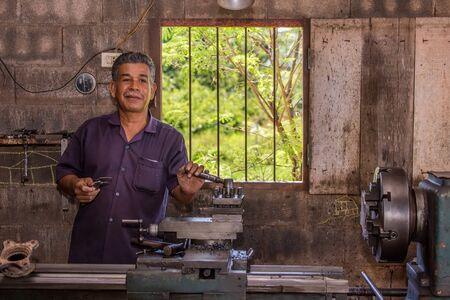 turner: Mechanic turner working in his workshop, Thailand Stock Photo