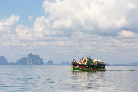 mook: Thai boat with passengers on the Andaman sea, going to Ko Mook island