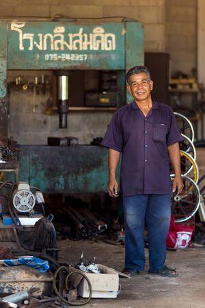 turner: Thai mechanic turner standing in his workshop, Thailand