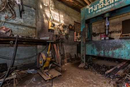 messy: View inside a messy mechanical turner workshop Stock Photo