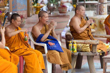chanting: NAKHON PATHOM, THAILAND, JANUARY 16, 2016 : Buddhist monks are chanting and praying outside the Wat Samphran temple in Nakhon Pathom near Bangkok, Thailand
