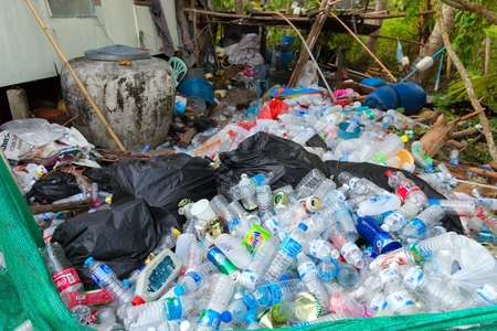 mook: KO MOOK ISLAND, THAILAND, JANUARY 07, 2016 : Heap of soda and water plastic bottle, stored before burning or recycling, Ko Mook island, Thailand