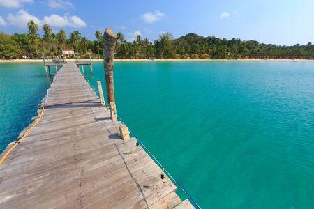kood: Wooden pontoon in the turquoise tropical sea of Ao Phrao beach in Ko Kood island, Thailand .