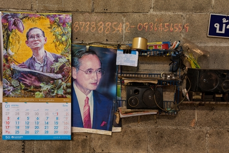 majesty: Illustration and calendar of Bhumibol Adulyadej, her majesty King of Thailand, pinned on a workshop wall