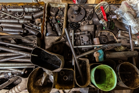 turner: Tools and vehicles parts in a mechanical turner workshop