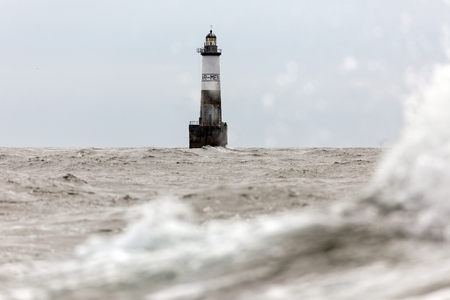 ar: The famous Armen lighthouse, classified as  The hell of hells, 16 kilometers in open sea, Brittany, France