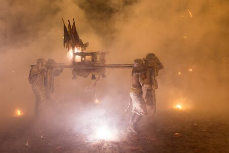 palanquin: Night religious procession under full smoke of firecrackers during the Phuket vegetarian festival, Thailand Stock Photo