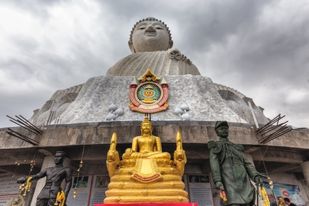 The Big Buddha at the top of the hill under a stormy sky, Phuket, Thailand Stock Photo
