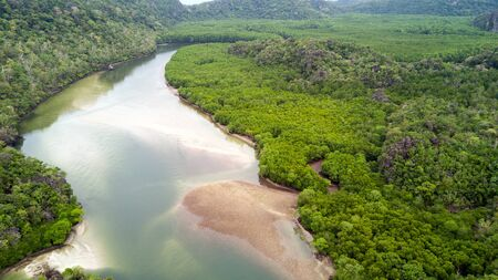 Aerial view of river and rainforest at Ao Phante Malacca beach, Koh Tarutao island, Thailand