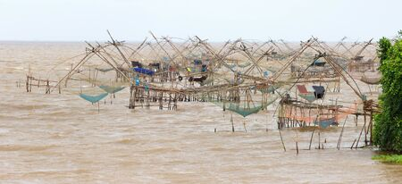Panorama of giant Chinese fishing nets at Phatthalung, south Thailand Stock Photo