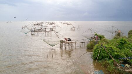 Aerial view of giant Chinese fishing nets at Phatthalung, south Thailand