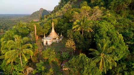 Aerial view of a gilded pagoda on a hill, Myanmar