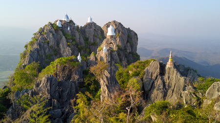 Aerial shot of the Chalermprakiat Prajomklao Rachanusorn chedis on the mountain top, Lampang province, Thailand
