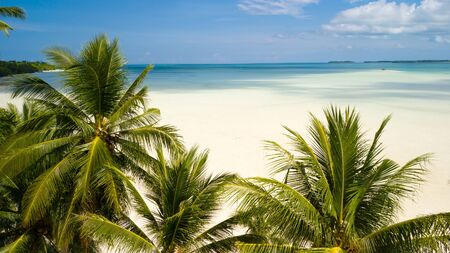 Aerial shot of deserted tropical Ohoidertawun beach with vast area of white sand, Kei Kecil island, Maluku, Indonesia Stock Photo