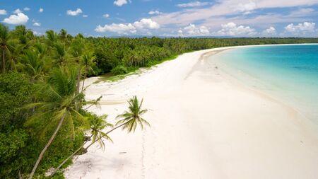 Aerial shot of the deserted tropical Ohoidertawun beach with vast area of white sand, Kei Kecil island, Maluku, Indonesia