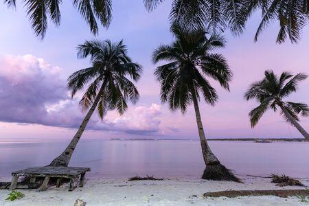 Pink dusk over a deserted tropical beach of Ohoidertawun, Kei Kecil island, Maluku, Indonesia Stock Photo