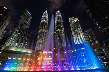 KUALA LUMPUR, MALAYSIA, FEBRUARY 13, 2018 : Multi colored musical fountain over the Petronas tower in Kuala Lumpur, Malaysia