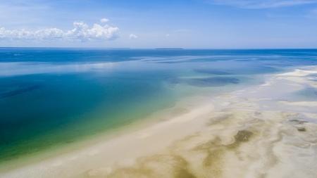 Aerial view of equatorial sea shore of Pulau Warmar island, Aru archipelago, Indonesia