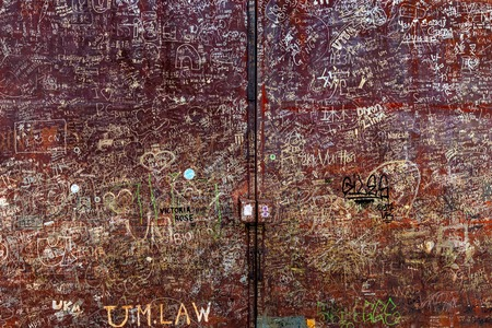 Street art writings on a rusty gate in the Georgetown city, penang, Malaysia