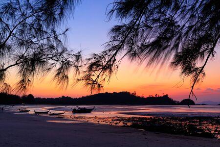 Tropical warm sunset under filao trees, Ko Phayam Island, Thailand