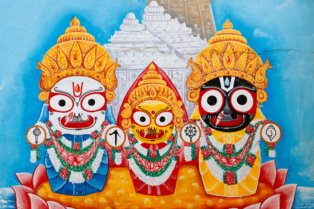 Urban painting of Jagannatha (Krishna) with his brother Balarama and sister Subhadra, Puri, India