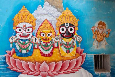 BHUBANESHWAR, INDIA, JANUARY 11, 2019 : Urban painting of Jagannatha (Krishna) with his brother Balarama and sister Subhadra